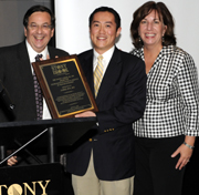 Dr. James Jen (center) receiving award from  Dr. Marc J. Shapiro (left) and trauma nurse coordinator Jane E. McCormack, RN (right).